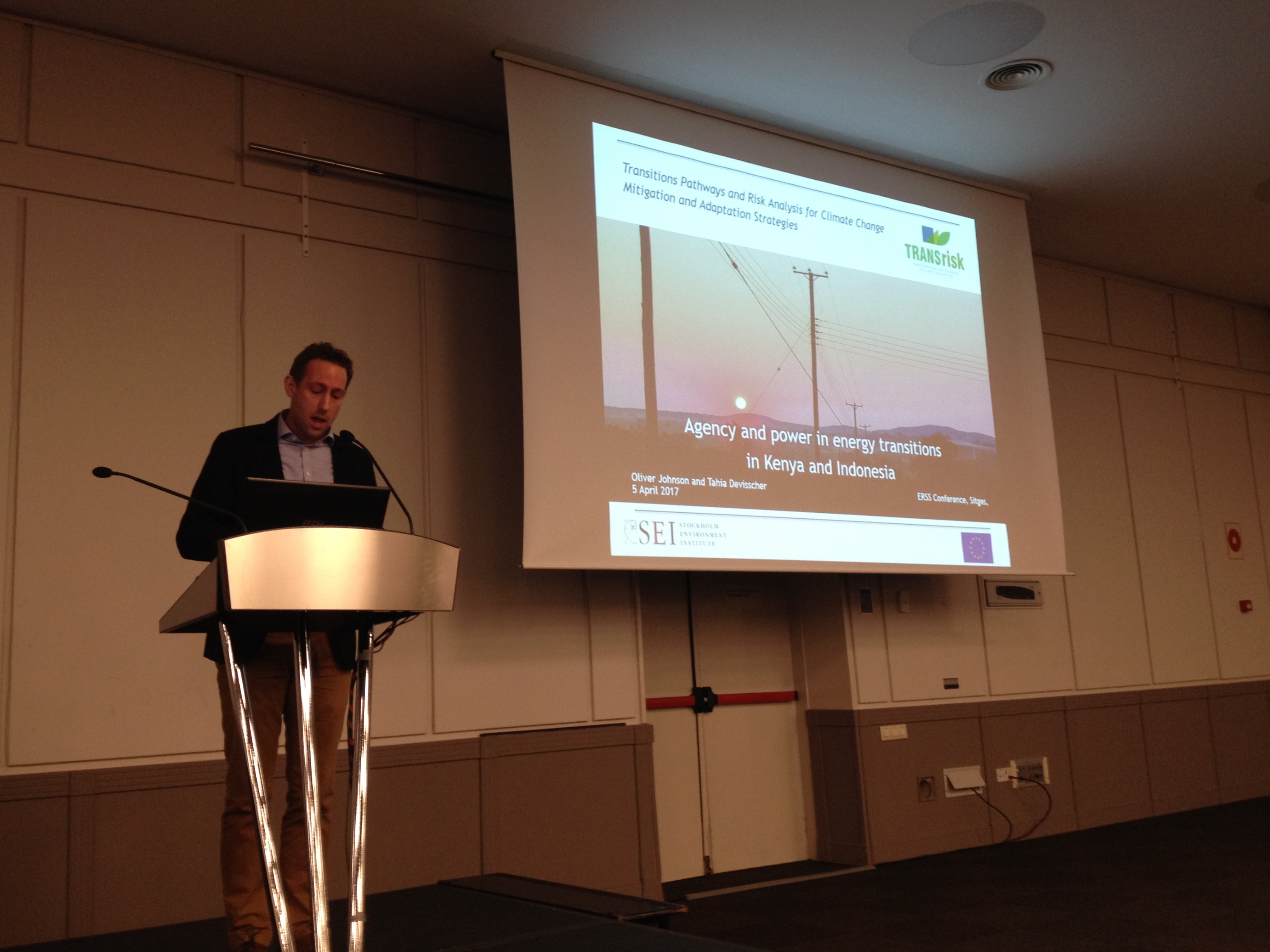 Oliver Johnson presenting biogas use in Indonesia & geothermal power in Kenya